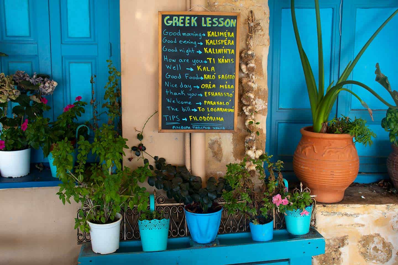 Image of a blackboard with Greek phrases translated into English Chania Crete Greece