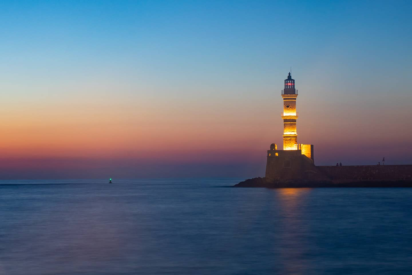 Image of Chania lighthouse at dusk Crete Greece