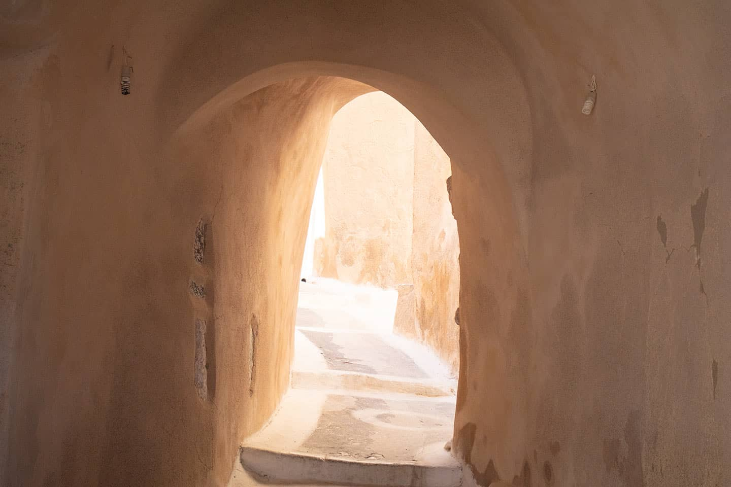 Image of a tunnel and street in the Kasteli district of Emporio Santorini Greece