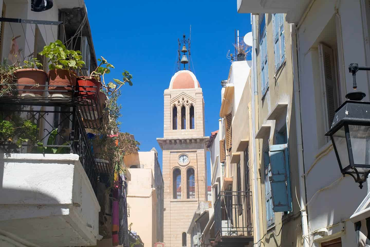 Image of the cathedral in Rethymno framed by houses