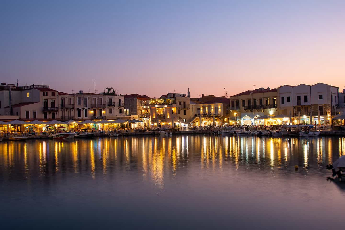 Image of the Venetian harbour in Rethymno old town at dusk