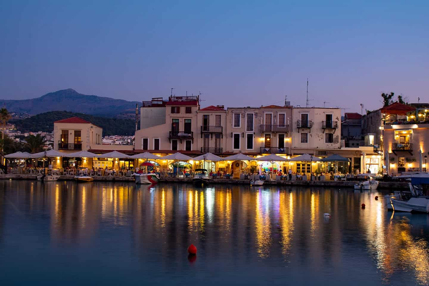 Image of the Venetian harbour of Rethymno at dusk