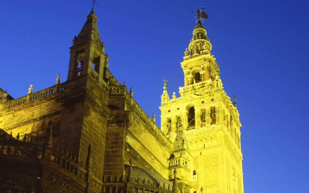 Best Places to Visit in Europe in October Image of the Giralda tower in Seville Spain at night