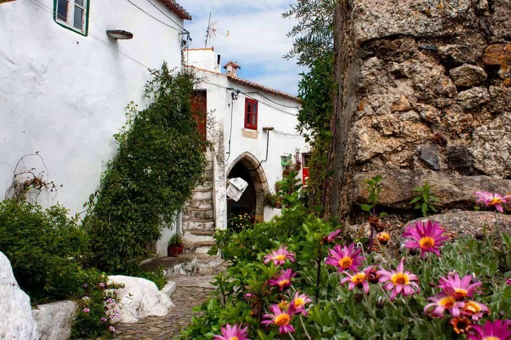 Image of a quiet street near the castle walls in Castelo de Vide Portugal