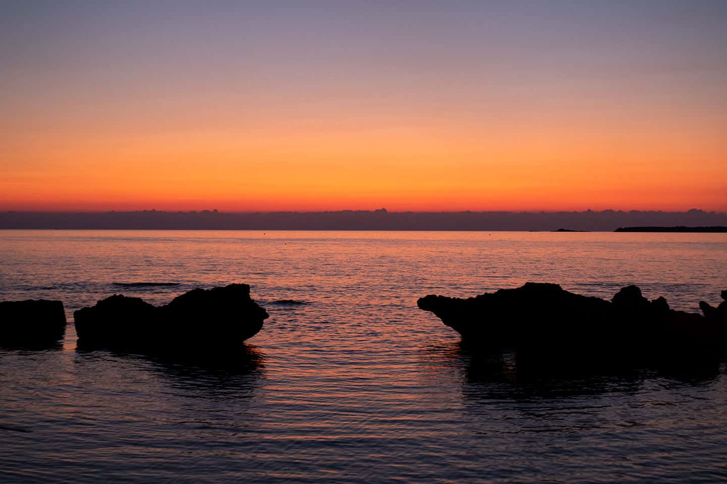 Image of rocks on Falassarna beach at sunset Crete Greece