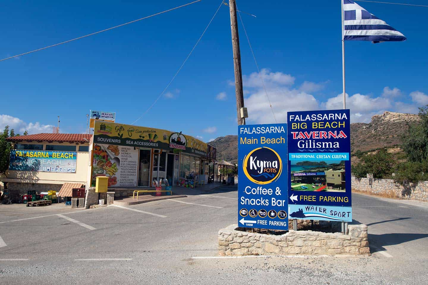 Image of Falassarna Market and signs to the main beach Crete Greece