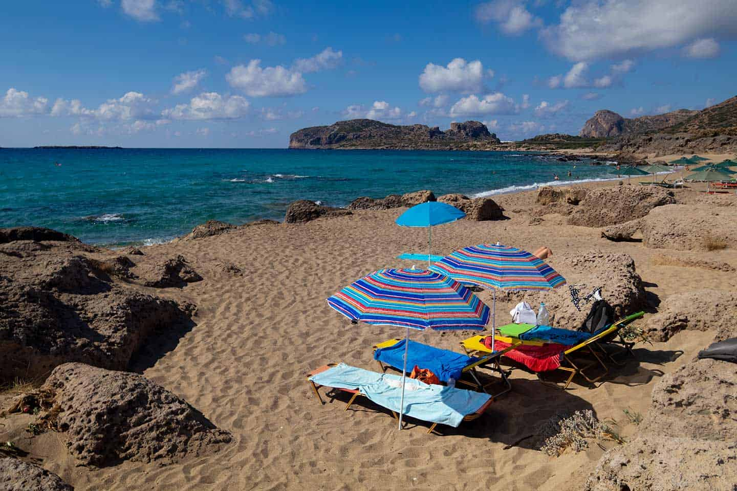 Image of sun umbrellas on Falassarna beach Crete Greece