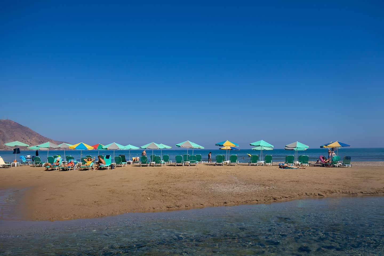Image of beach umbrellas on Georgiopupolis beach Crete Greece