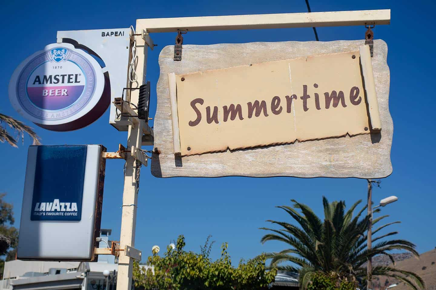 Image of the Summertime cafe sign in Georgioupolis village