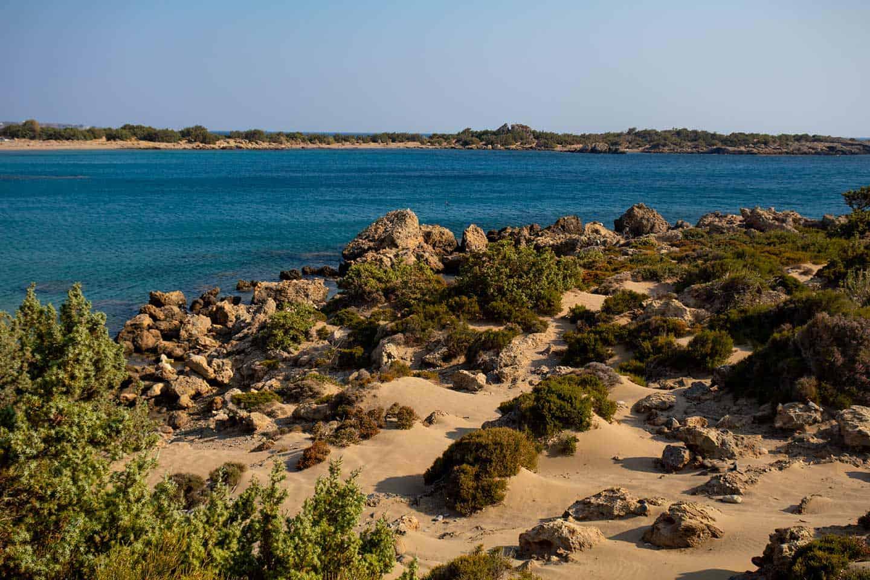 Image of the sand dunes and juniper trees at Grammeno wild beach Crete