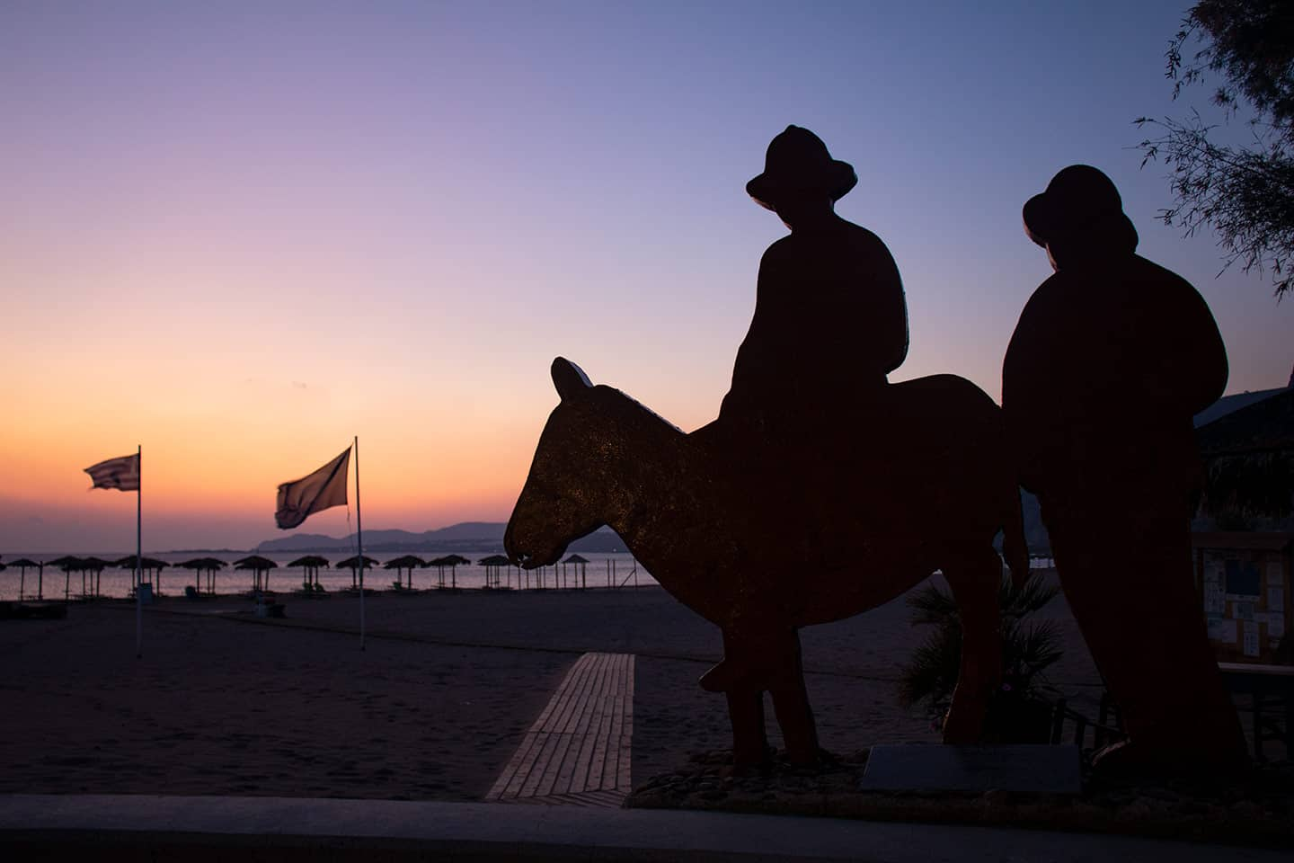 Image of 'The Travellers' sculpture on Paleochora seafront