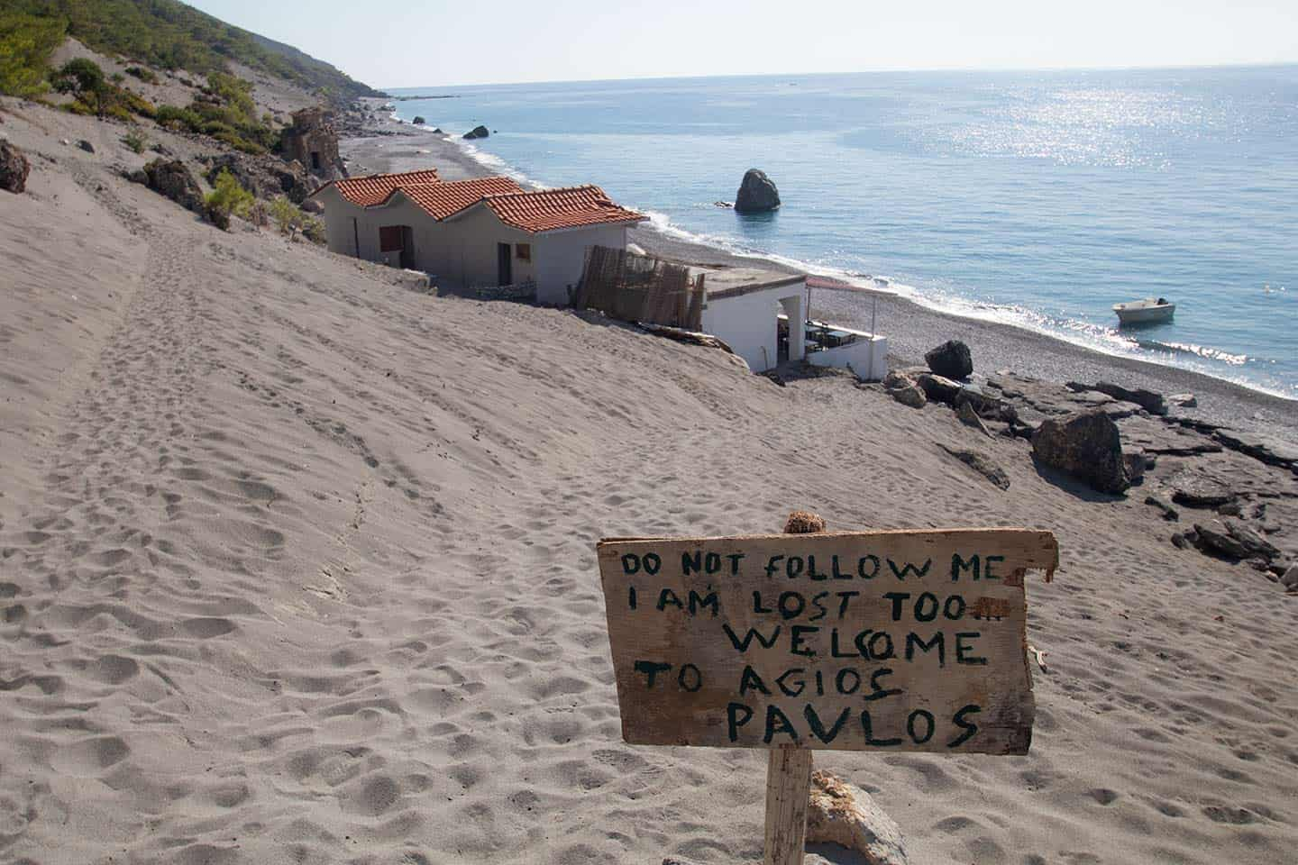 Image of a sign welcoming visitors to Agios Pavlos Beach and Church, Crete
