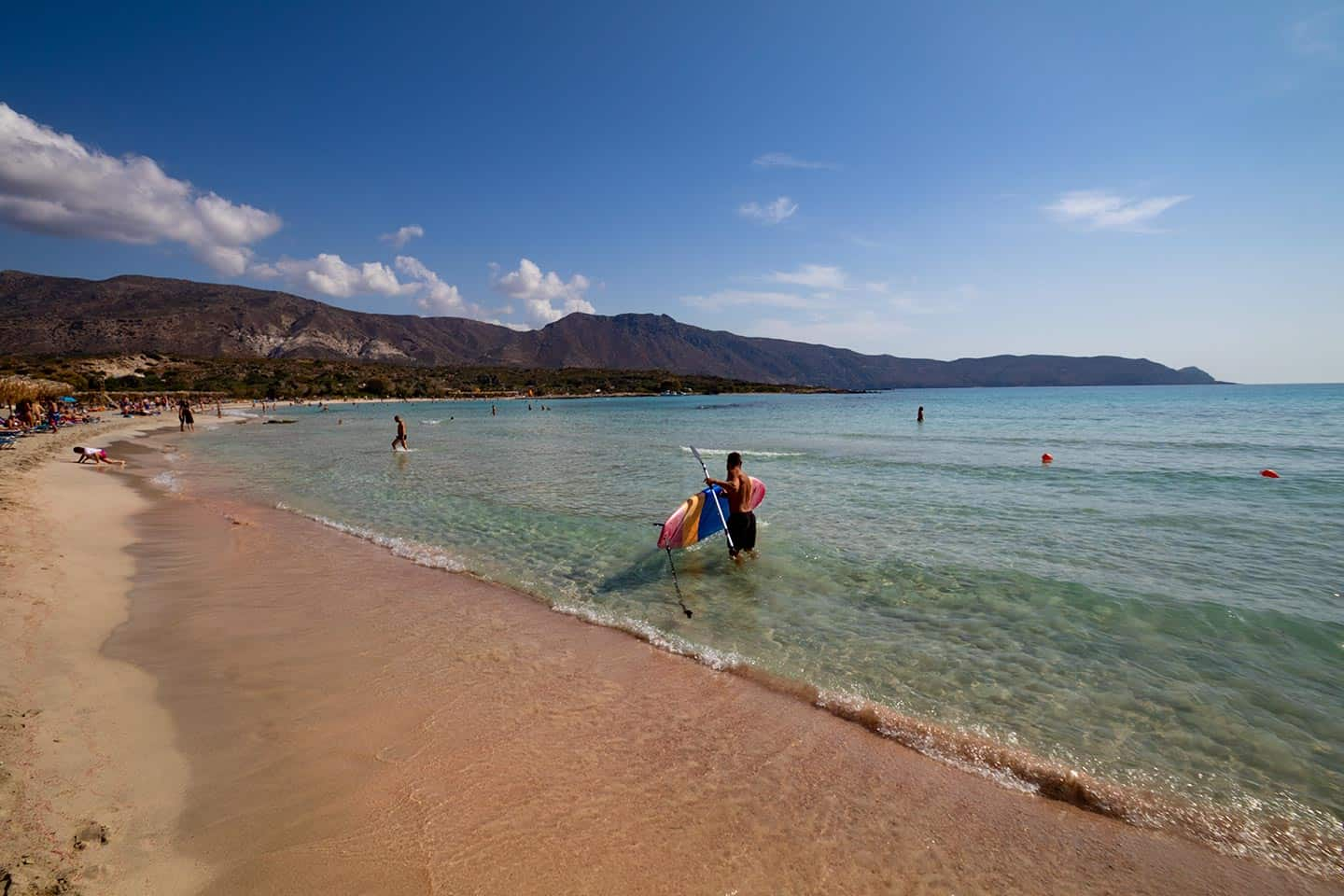 Image of a stand-up paddleboarder at Elafonissi Beach on Crete