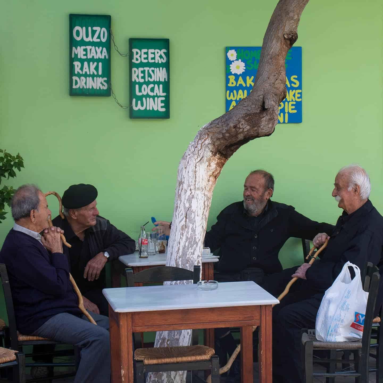 Image of Greek men chatting at a cafe in Paleochora Crete
