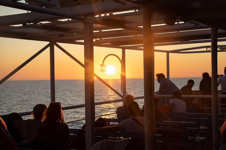 Image of ferry returning to Paleochora Greece at sunset