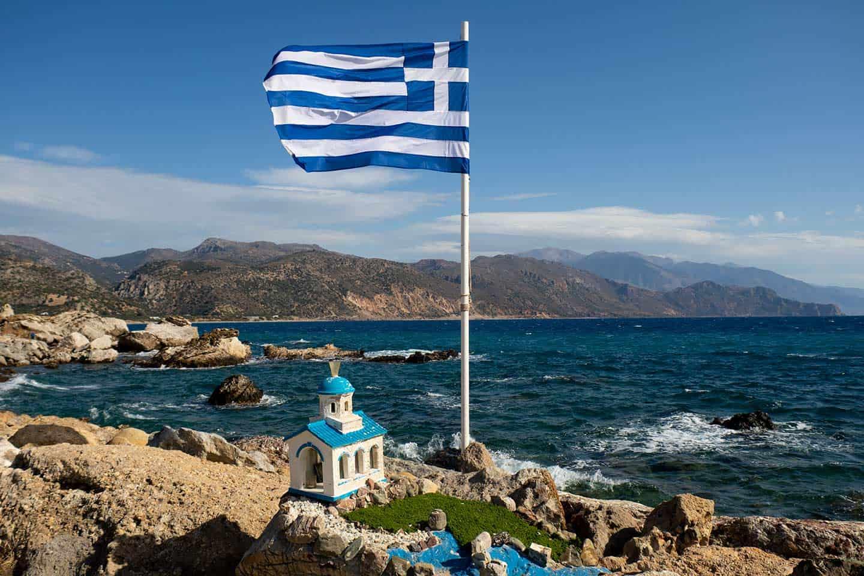 Image of a shrine and the the Greek flag near Methexis Beach Paleochora Crete