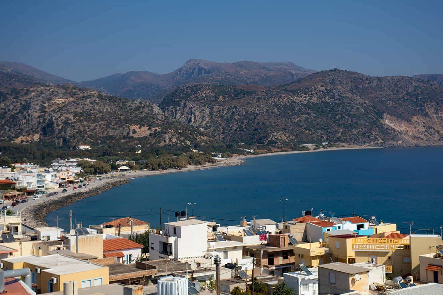 Crete weather Image of the town of Paleochora in sunny weather with blue sky