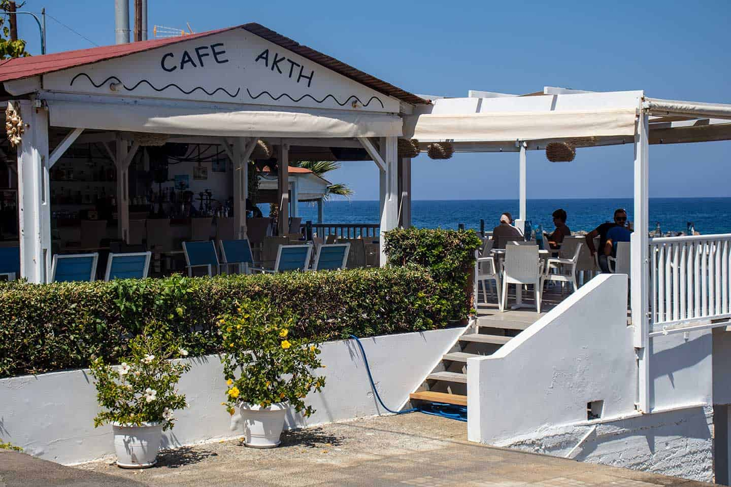 Panormo beach Image of Cafe Akti on the seafront at Panormos beach