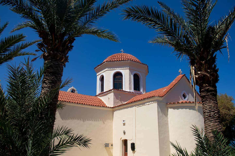 Panormos beach Crete Image of church in Panormos village Crete