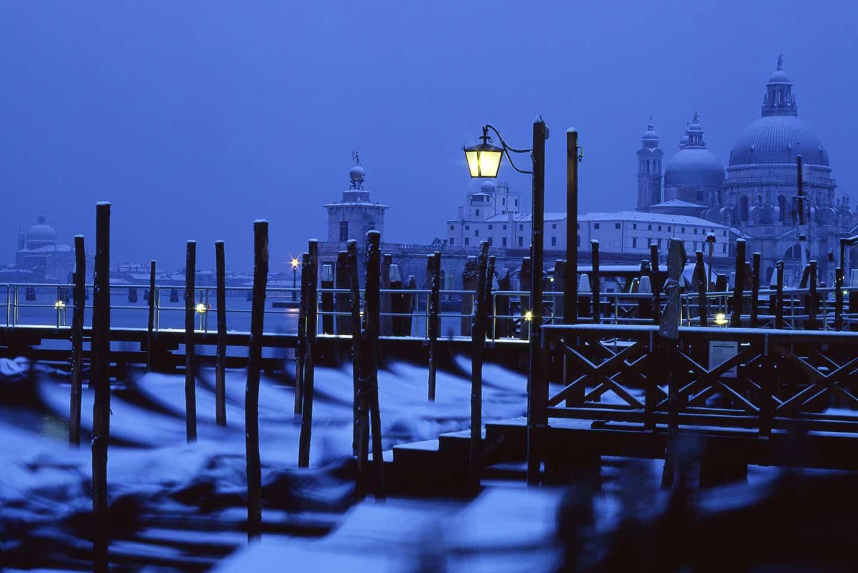Snow in Venice Image of gondolas and Santa Maria della Salute covered in snow